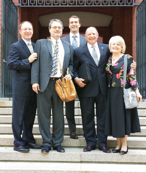 Mr. Hoffman (with litigation bag) with Danny and Del Ross, Mrs. Ross, and co-counsel Ian Crosby (rear) on the steps of the Federal Circuit Court of Appeals in D.C. after oral argument in May 2014
